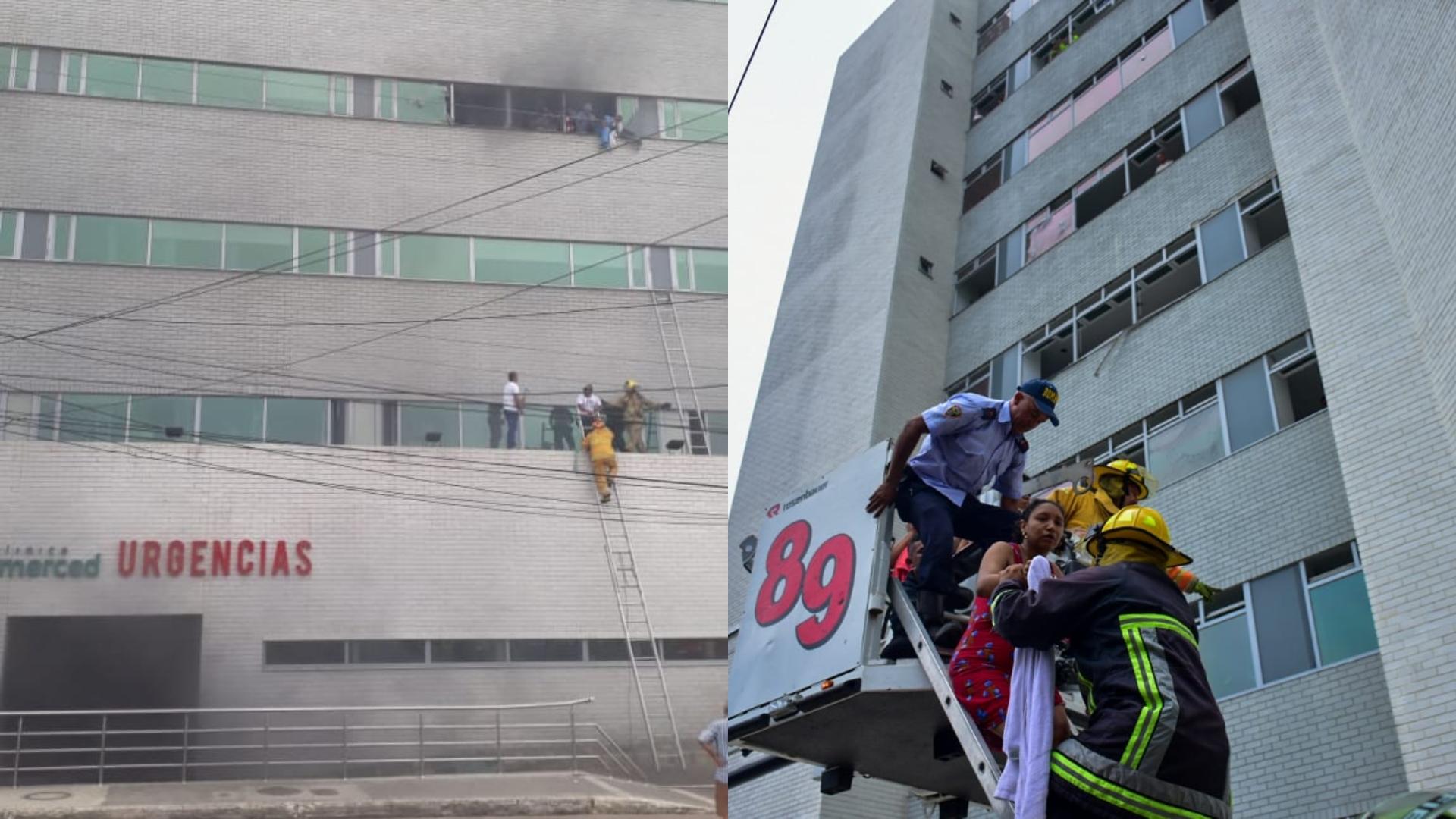 Momento en que los bomberos rescatan al personal en la clínica.