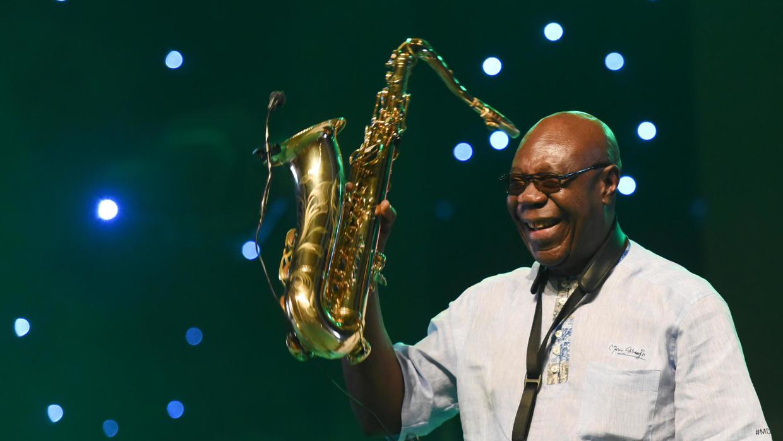 Fue cofundador de la orquesta The African Team con la que se exilió  en París.