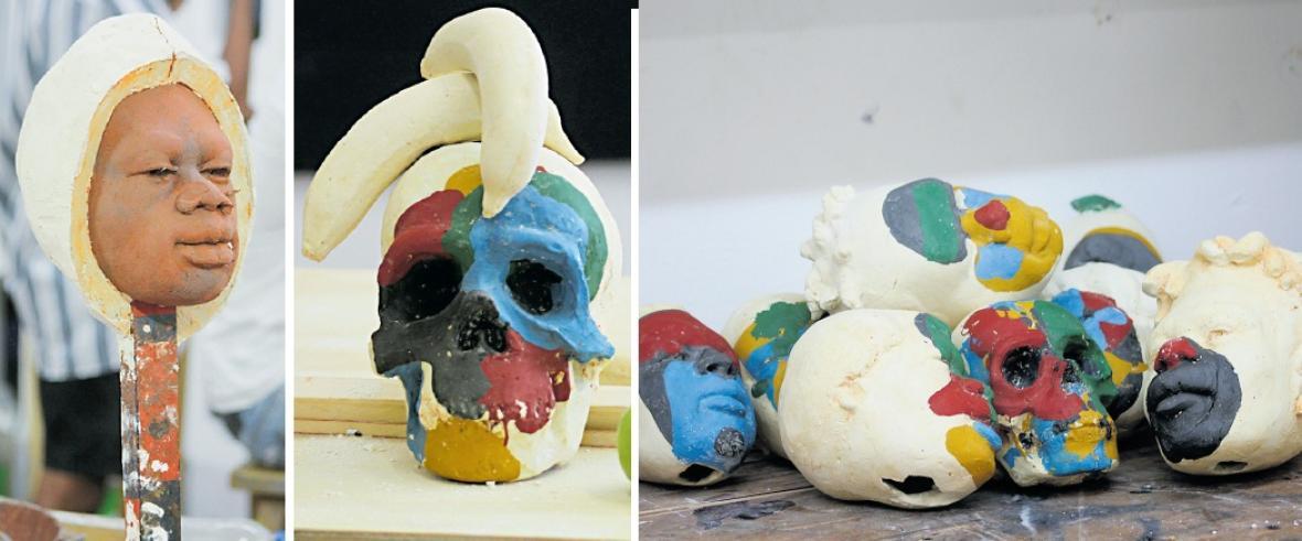 1) Escultura de un rostro. 2) Figura caribeña. 3) El colorido es importante en la obra.