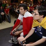 Representantes de Colombia y Perú peleando en Super Smash Bros Melee en Astra.