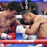 Pacquiao vence a Thurman y se corona campeón wélter
