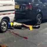 Hallan a vigilante muerto en plena calle
