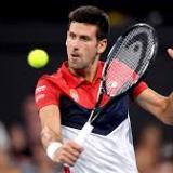 Novak Djokovic en acción durante un juego.