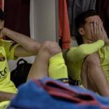 Sergio Busquets y Coutinho tras la derrota ante el Liverpool en la Liga de Campeones 2018-2019.