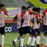 Fabián Ángel celebró con Luis González la primera anotación de Junior.