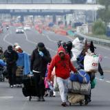 Un grupo de migrantes que se vio forzado a abandonar el país en medio de la emergencia sanitaria.