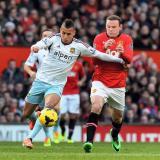 Ravel Morrison y Wayne Rooney, jugando en contra una vez el canterano salió del Manchester United.