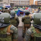 Policía abre investigación por quema de pertenencias de migrantes en Chile