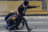 Manifestantes en la marcha del pasado miércoles en Caracas, Venezuela.