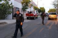 Agentes de la Policía llegaron al lugar donde fue asesinado el sacerdote Juan Miguel Contreras García.