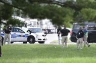 La policía del condado de Hardord rodea el sitio del ataque.