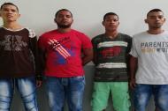 Los cuatro señalados delincuentes capturados en diligencias de allanamiento y registro.