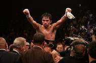 El boxeador filipino Manny Pacquiao celebrando su triunfo.