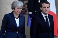 Theresa May y  Emmanuel Macron.