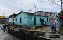 Vivienda en Barrio Abajo que quedó en riesgo de colapso por las lluvias de ayer.