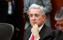 Alvaro Uribe Vélez, senador.