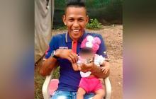 El joven asesinado y la bebé de nueve meses que resultó herida.
