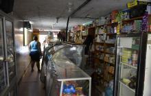 Tienda sin luz en el barrio Ciudadela 20 de Julio.