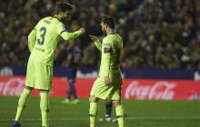 Piqué y Messi, compañeros en el Barcelona.
