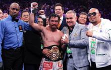 El filipino Manny Pacquiao con el cinturón mundial.