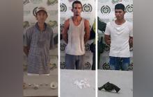 Los tres capturados con droga y arma de fuego.