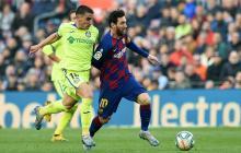 Lionel Messi jugando con el Barcelona en un partido ante el Getafe.