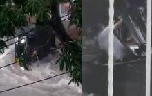 En video | Así se salvó docente que era arrastrado en su carro por un arroyo
