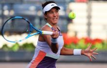 La tenista española Garbiñe Muguruza en acción durante un juego.