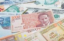 Cotización del dólar cae este jueves por debajo de $3.700