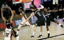 Jimmy Butler anotó dos tiros libres antes que sonase la bocina y aseguró este miércoles la victoria por 116-114 de los Heat de Miami ante los Bucks de Milwaukee.