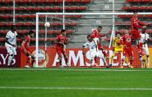 Acción del juego entre Unión La Calera y Deportes Tolima.
