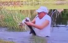 En video   Hombre salva a su cachorro de ser devorado por un Cocodrilo