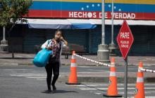 Migrantes venezolanas trabajan más horas y devengan mitad que las colombianas