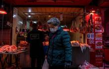 China lucha por frenar al virus un año después del histórico cierre de Wuhan