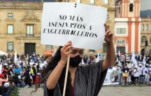 Una manifestación en contra del homicidio de excombatientes.