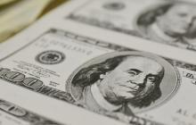 Dólar abre a la baja tras fin de la Semana Santa