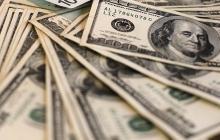 Dólar arranca negociaciones a la baja