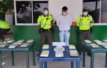 Lo capturaron con 11 kilos de marihuana en un bus