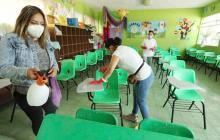 Pese a la tercera ola de covid, México se prepara para regresar a las aulas