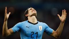 Edinson Cavani festeja uno de sus dos goles convertidos ante Portugal.