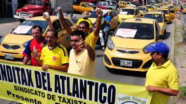 Miembros de la agremiación Sinditax durante la movilización que se llevó a cabo ayer.