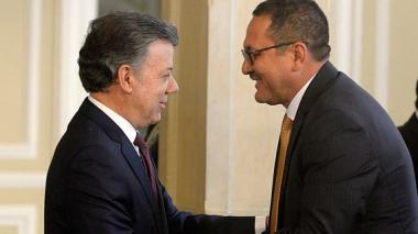 Juan Manuel Santos y  César Palomino.