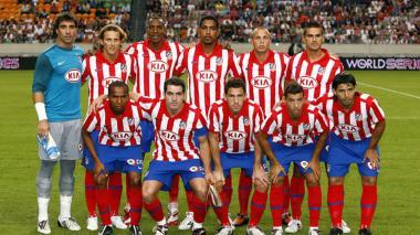 Luis Amaranto Perea al lado de Cléber, en el Atlético.