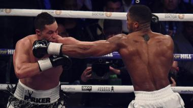 Joshua vence a los puntos a Parker en pelea por unificación de títulos de los pesados