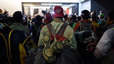 Caravana migrante se fragmenta, cientos salen de Ciudad de México a EEUU