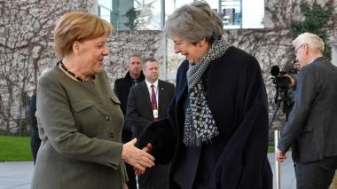 Angela Merkel y Theresa May.