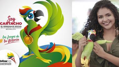 'Cartacho', el guacamayo verde limón que será el anfitrión de los Juegos del Bicentenario. Al lado, su diseñadora, la cartagenera Martiza Buelvas.