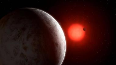 Representación artística de la estrella Gliese 887, cuyo sistema planetario compacto es el más cercano al Sistema Solar, está formado por dos planetas y, posiblemente, un tercero, aún por confirmar.