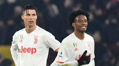 Cristiano Ronaldo junto al colombiano Juan Guillermo Cuadrado en la Juventus.