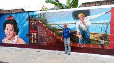 El artista plástico Armando Cervantes, quien ha pintado muchos murales en el municipio El Banco y lo ha convertido en un museo de arte al aire libre.